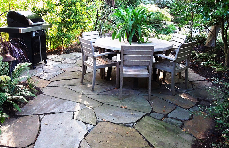 Patio Created From Large Pieces Of Random Cut Flagstone Set In Sand Is  Stable,