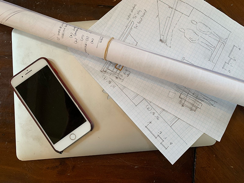 Photo of a cell phone and blueprints