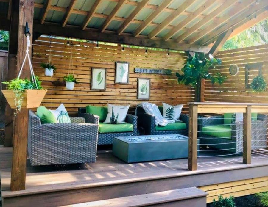 Screened on two sides, this outdoor room in a previously unused corner of     the garden looks out on the larger landscape and provides a space for     drinks by the fire table in the evening and listening to birds over coffee     in the morning.
