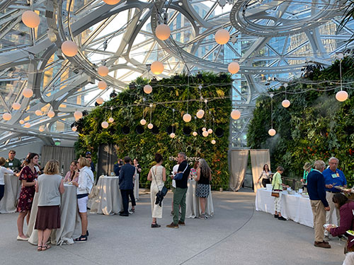 People at the Spheres in Seattle at a cocktail reception.