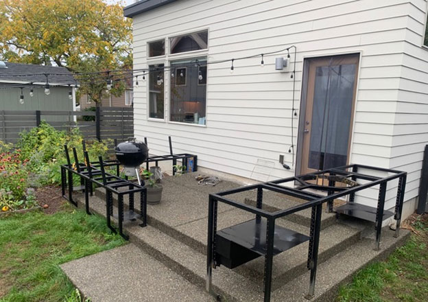Metal frames mounted on existing concrete patio in West Seattle.