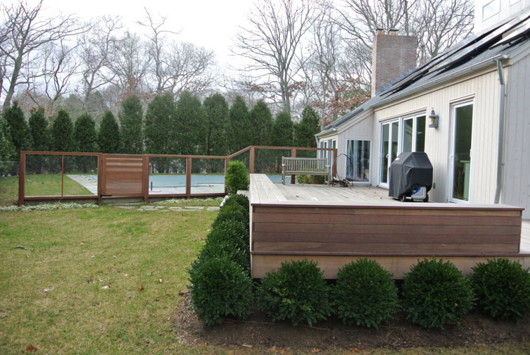 backyard landscape design, deck with surround shrubs and pool in back