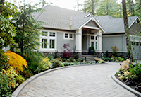 View of the new paved driveway entry design by Vanessa  Gardner Nagel